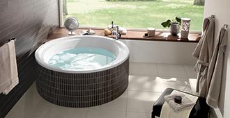 Vasche da bagno rilassarsi con eleganza villeroy boch for Vasche da bagno rotonde